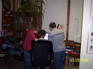The boys using the computer